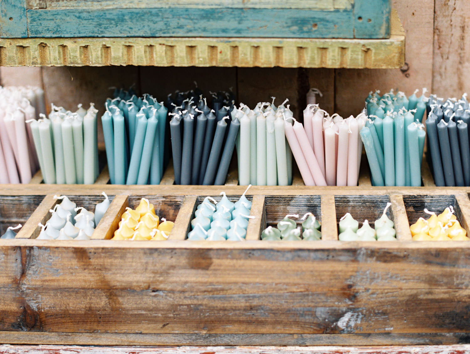 Colored pastel taper candles at Petersham Nurseries on the Flutter Magazine Retreat, film by Cavin Elizabeth Photography
