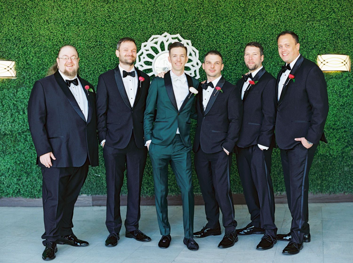 Groom in dark teal tuxedo and groomsmen in black tuxedos. Riviera Palm Springs Wedding by Cavin Elizabeth Photography