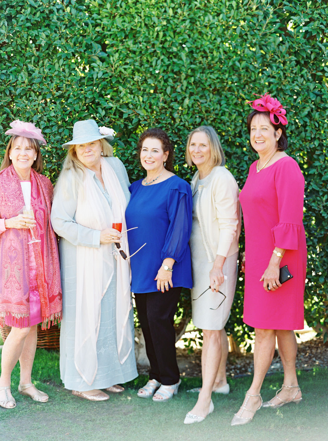 Wedding guests dressed in derby day attire. Palm Springs wedding outfits. Cavin Elizabeth Photography