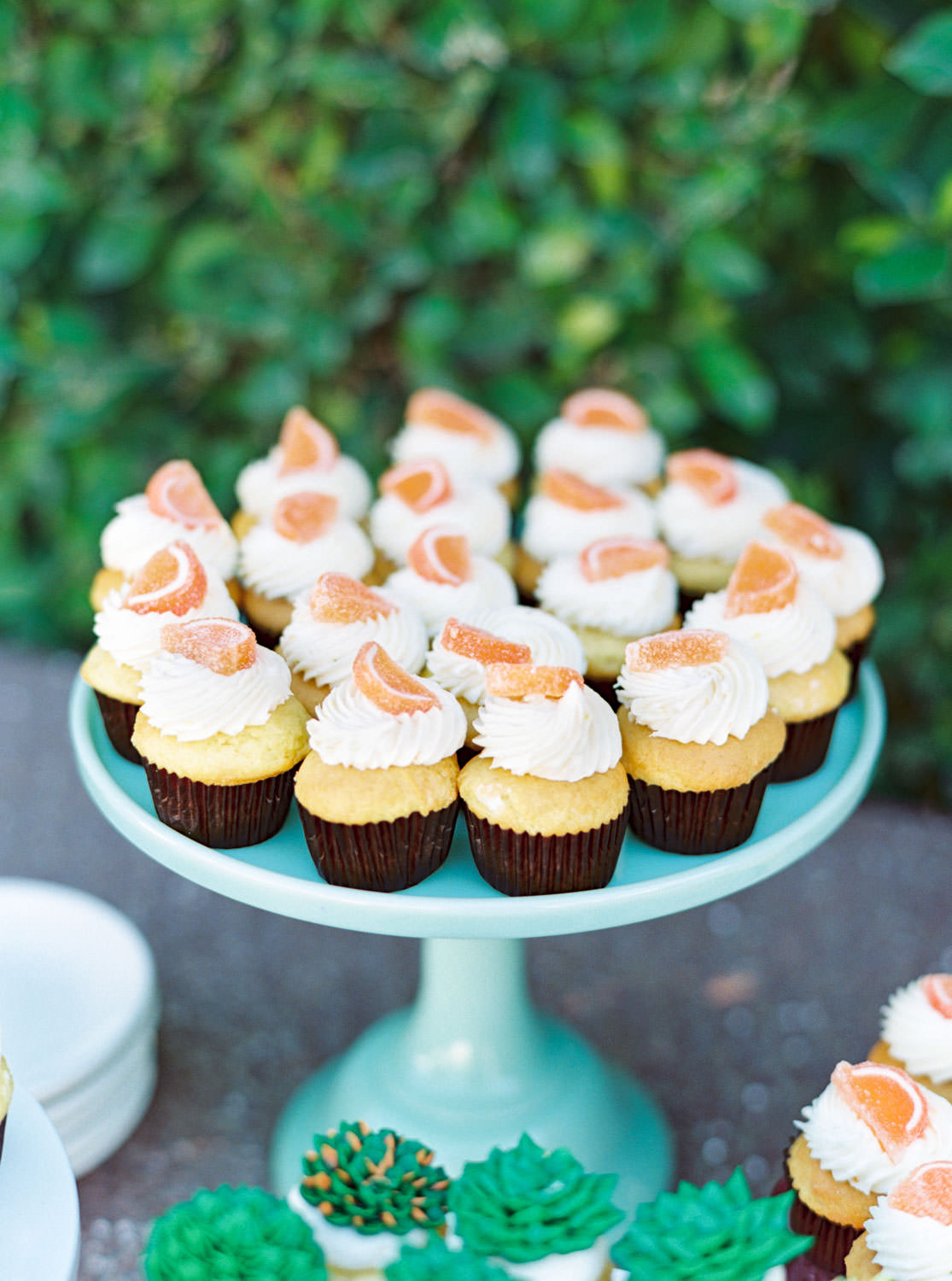 Dessert table with rose gold sequin linen. Tropical desert inspired desserts with succulent icing cupcakes and cupcakes topped with a candy orange slice. Riviera Palm Springs Wedding by Cavin Elizabeth Photography