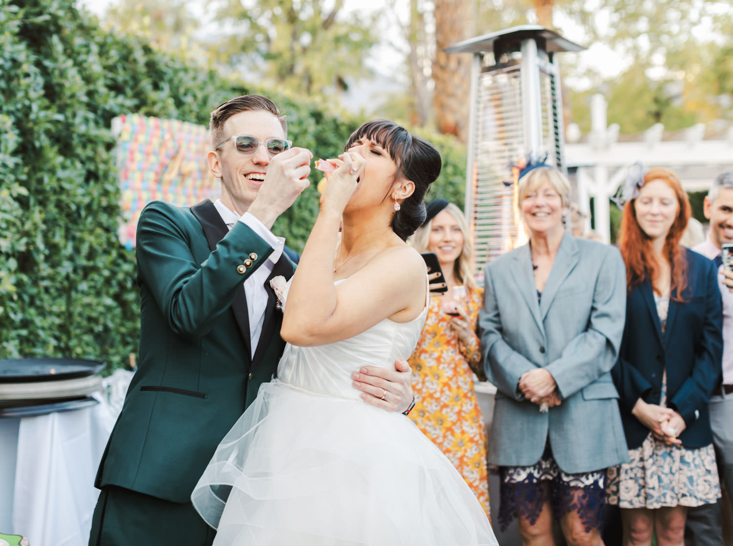 Bride and groom have fun while cutting their cake. Riviera Palm Springs Wedding by Cavin Elizabeth Photography