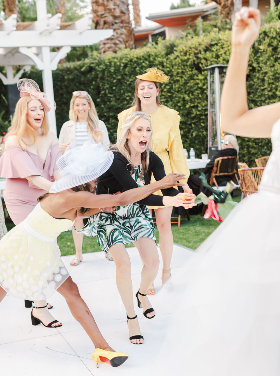 Bridesmaids leap for bouquet. Riviera Palm Springs Wedding by Cavin Elizabeth Photography