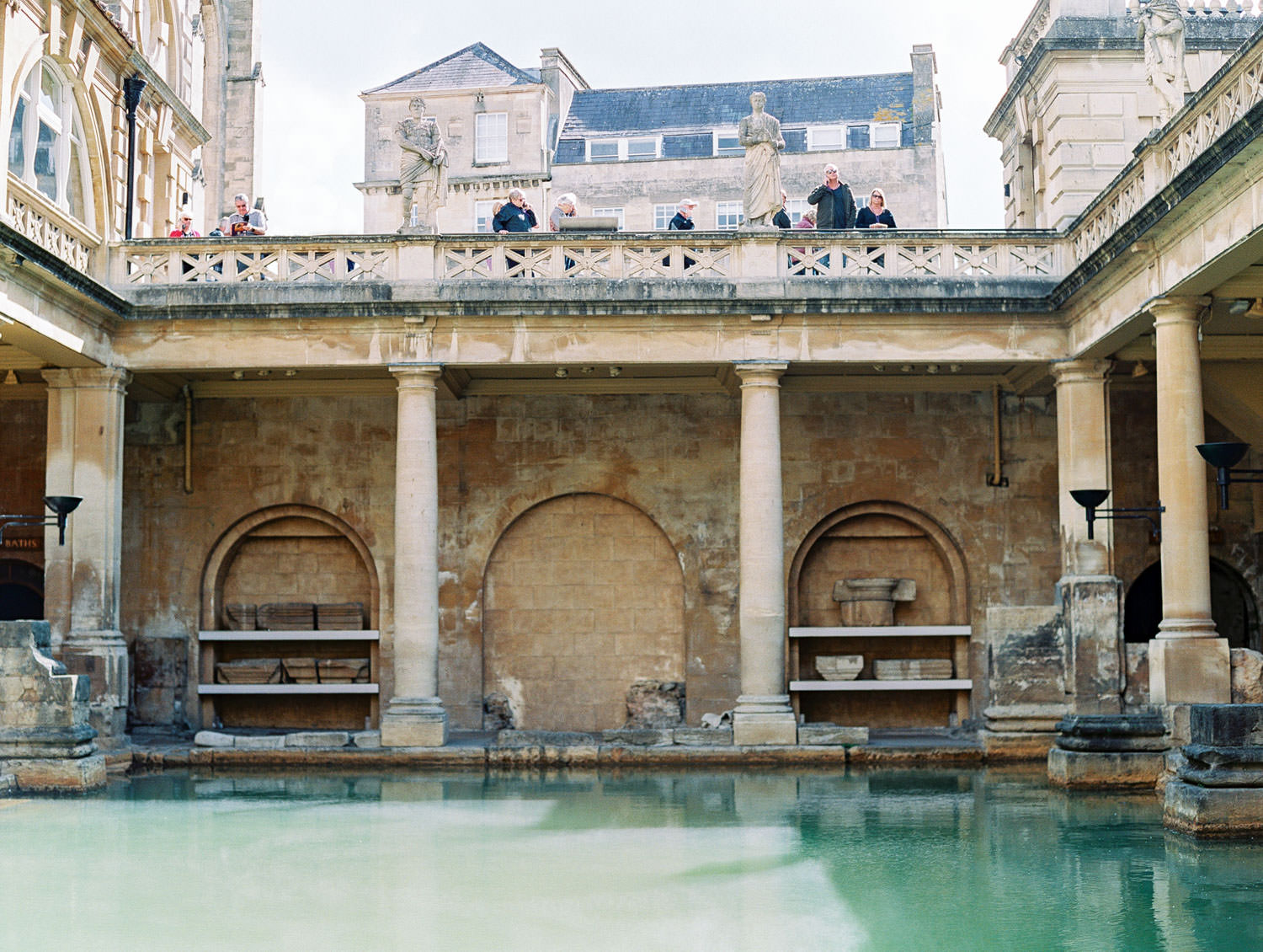 Bath surrounded by walls and columns at The Roman Baths in Bath England, Cavin Elizabeth Photography
