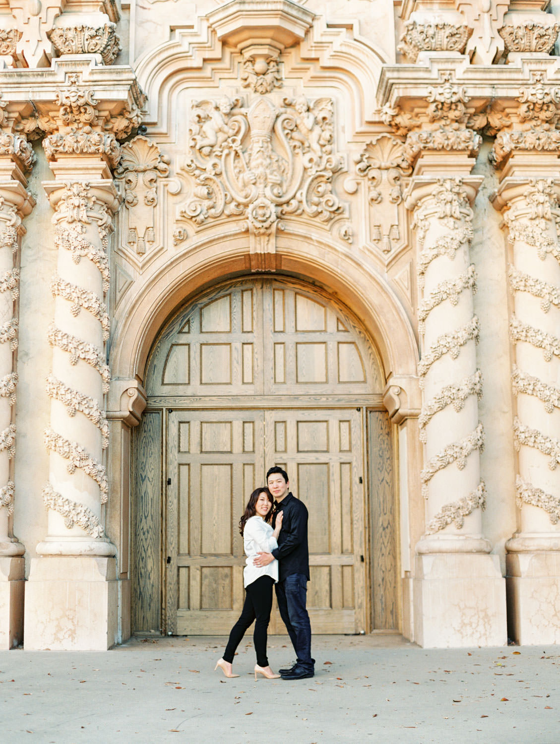Engagement photos at Casa Del Prado Theatre with bride in black jeans and white button down and groom in charcoal button down and dark jeans, film photographer Cavin Elizabeth in San Diego