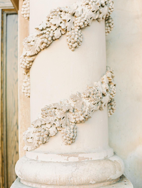 Casa Del Prado Theatre column with grape leaves spiraling the column in a Churrigueresque style, film photographer Cavin Elizabeth in San Diego