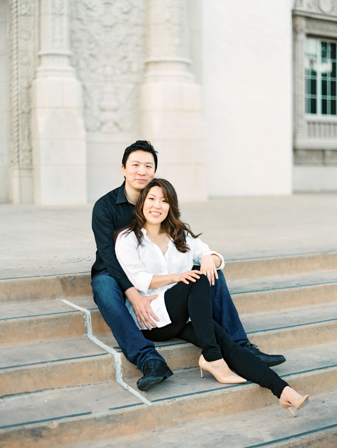 Engagement photos with bride in black jeans and white button down and groom in charcoal button down and dark jeans, film photographer Cavin Elizabeth in San Diego