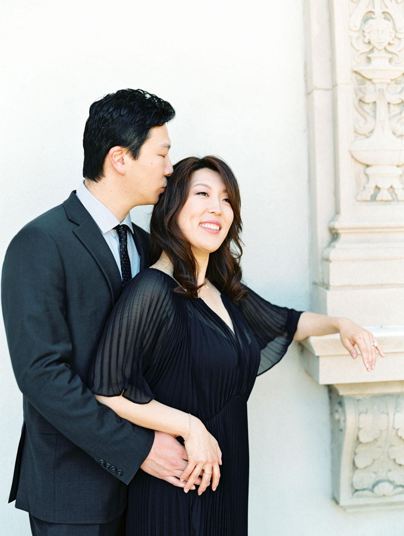 Engagement photos with bride in black dress and groom in dark grey suit, film photographer Cavin Elizabeth in San Diego