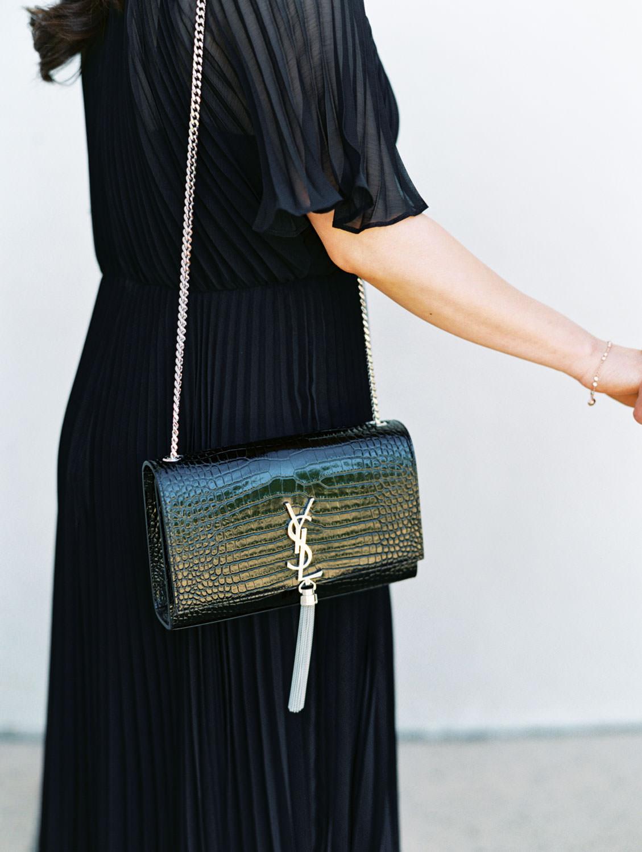 Engagement photos in Balboa Park with bride in black dress with black YSL handbag, film photographer Cavin Elizabeth in San Diego