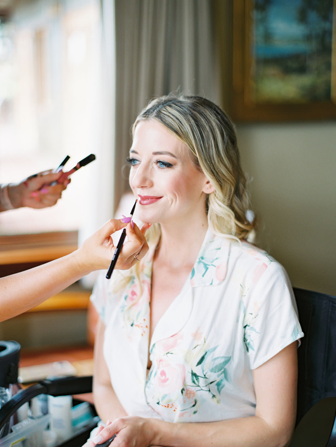 Bride having her lipstick touched up for getting ready photo, Lodge at Torrey Pines wedding, film photography by Cavin Elizabeth Photography