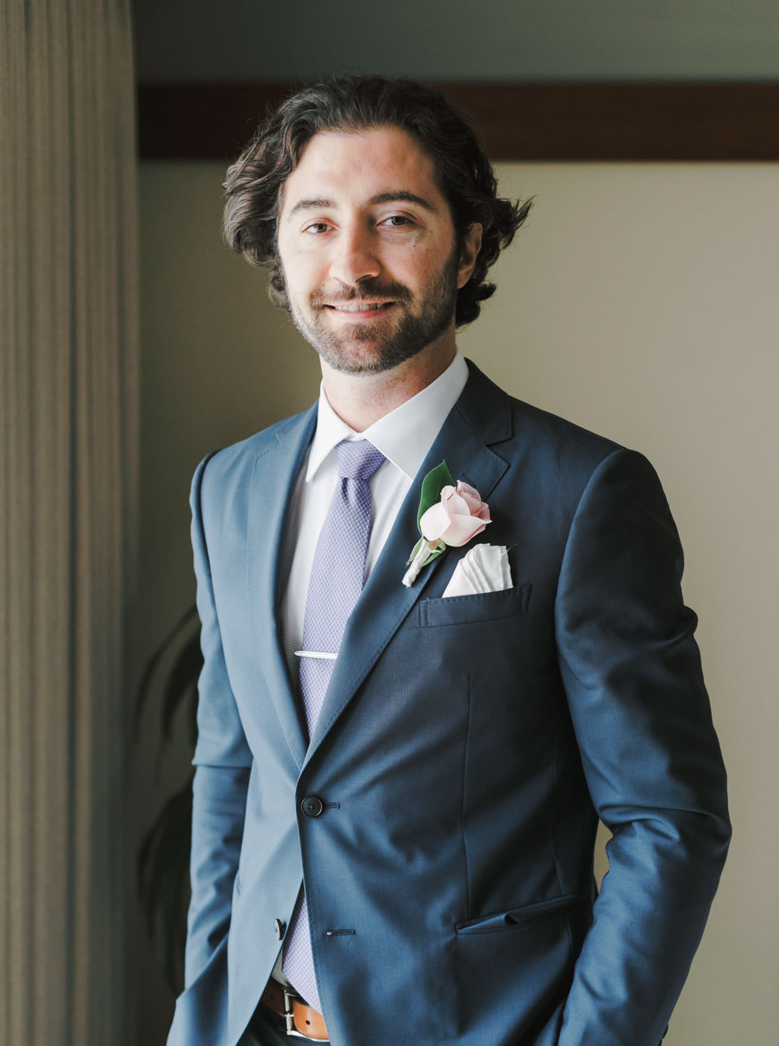 Groom in navy suit with blush rose boutonniere, Lodge at Torrey Pines wedding, photography by Cavin Elizabeth Photography