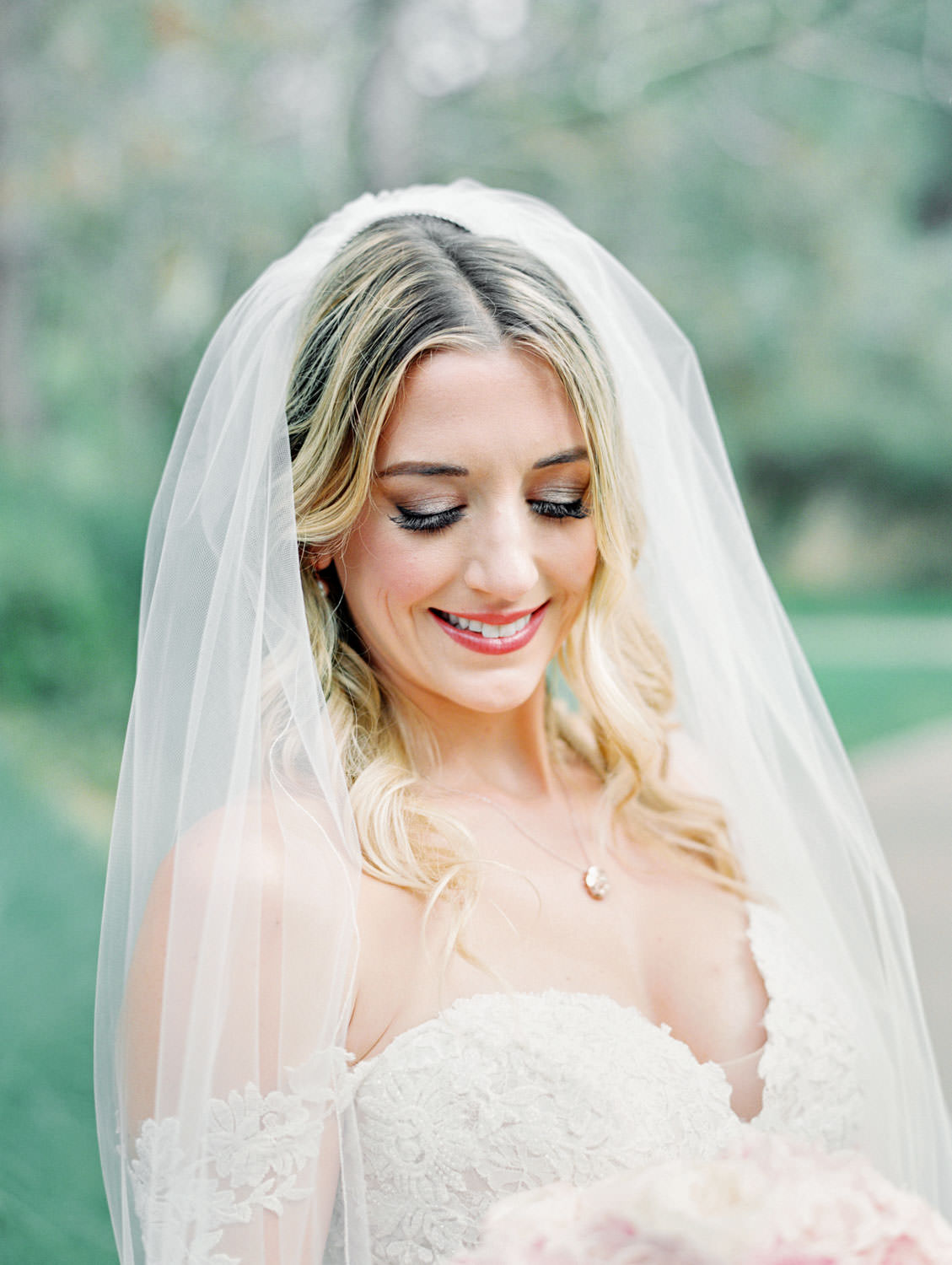 Bride in Pronovias off shoulder lace gown with veil and hair curled and down, classic bridal portrait, Lodge at Torrey Pines wedding, film photography by Cavin Elizabeth Photography