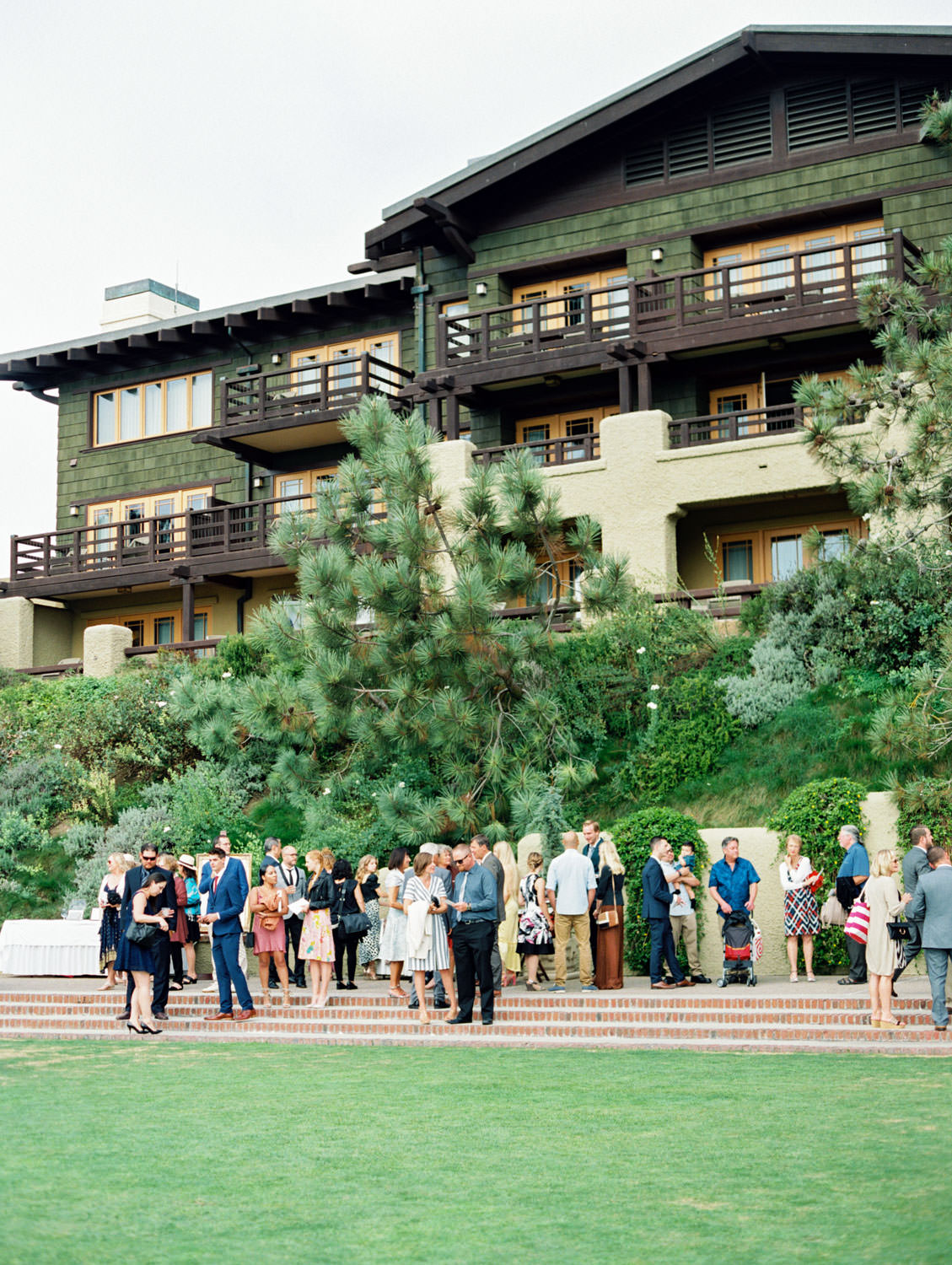 Guests during cocktail hour outside at a rustic upscale venue in San Diego, Lodge at Torrey Pines wedding, film photography by Cavin Elizabeth Photography