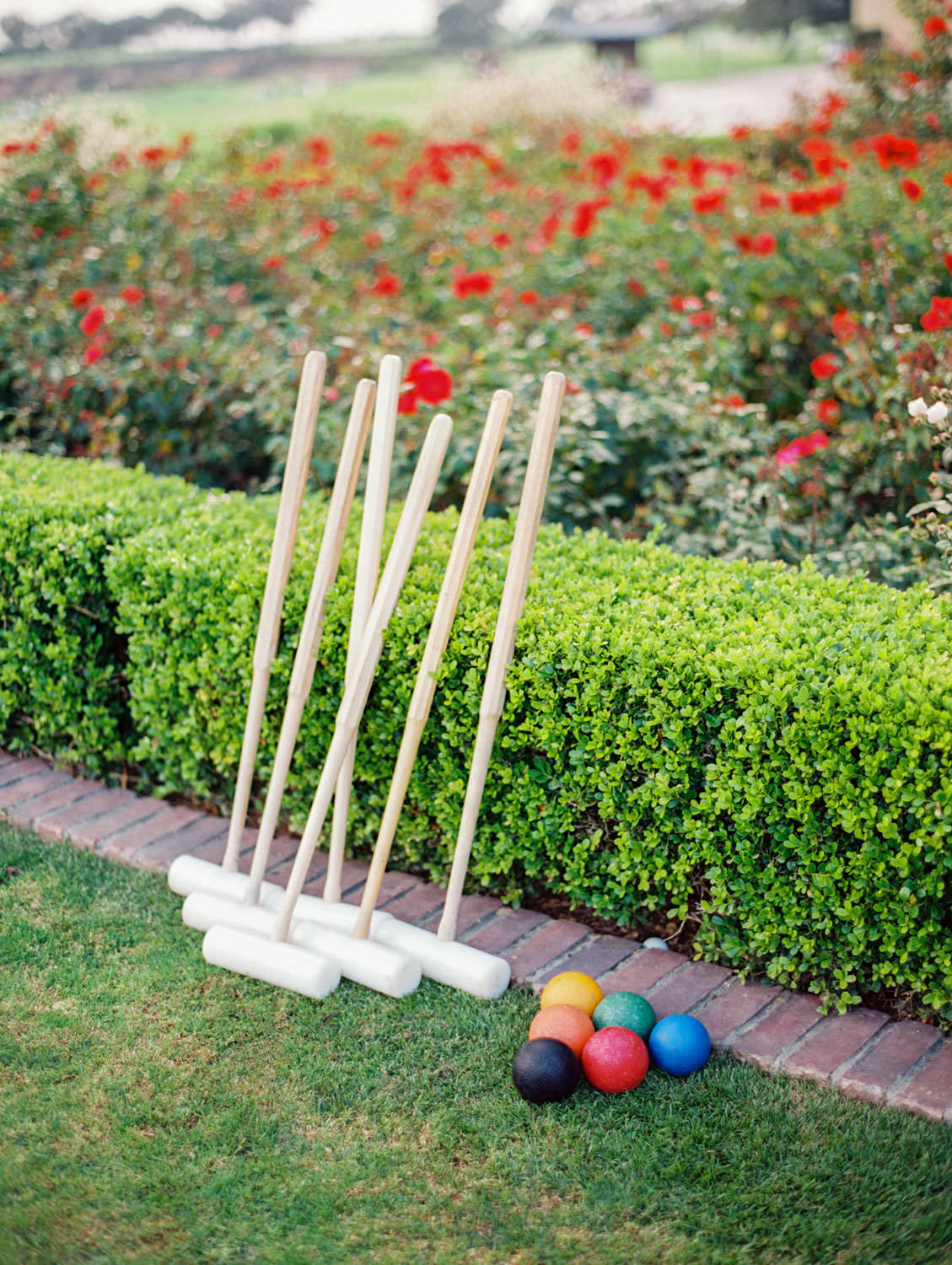 Croquet set during cocktail hour outside at a rustic upscale venue in San Diego, Lodge at Torrey Pines wedding, film photography by Cavin Elizabeth Photography