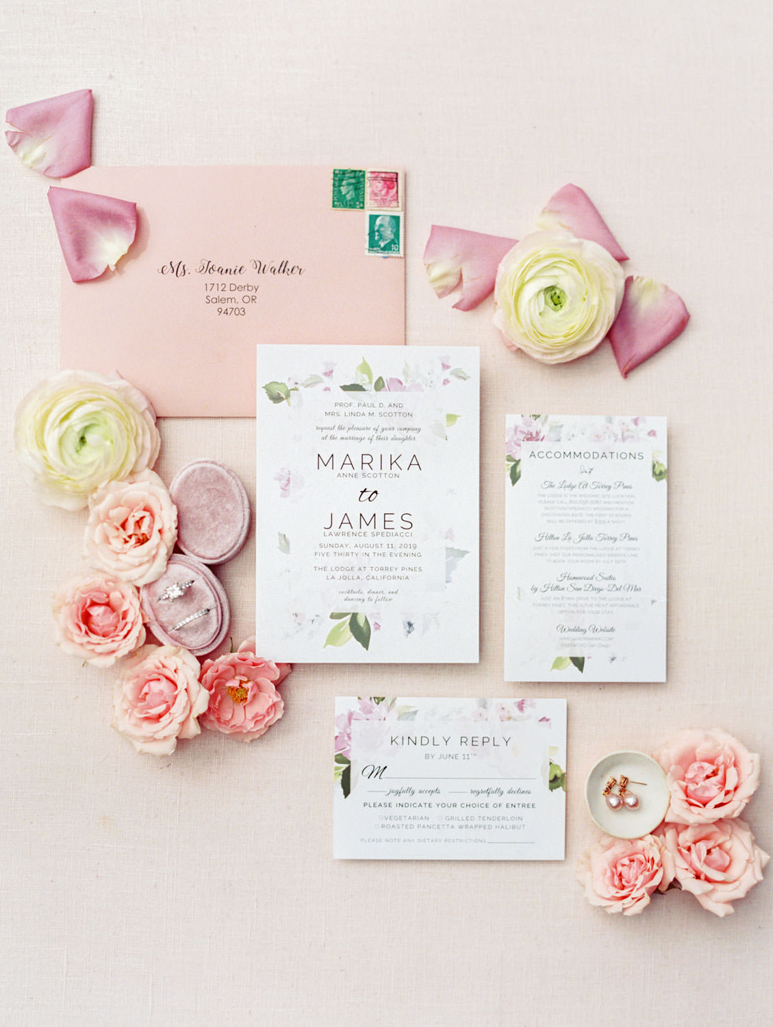 White wedding invitation with green and lavender floral border and pink envelope, matching details cards, film photography by Cavin Elizabeth Photography