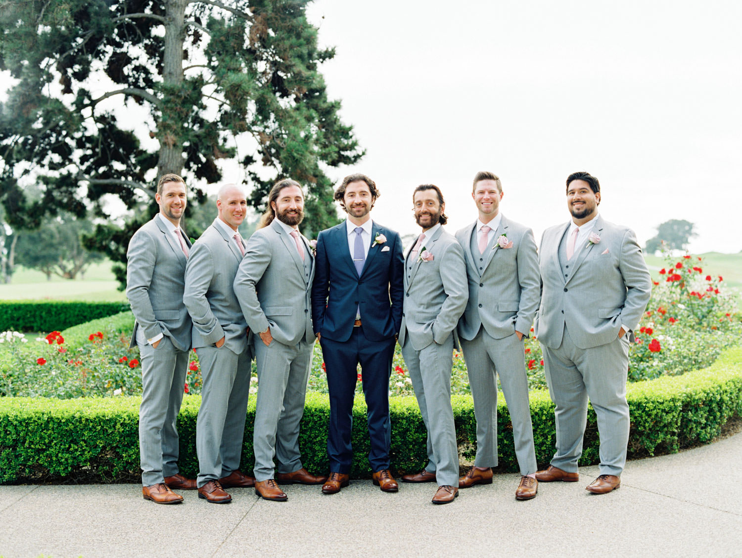 Groomsmen in light grey suits and groom in navy suit, Lodge at Torrey Pines wedding, film photography by Cavin Elizabeth Photography