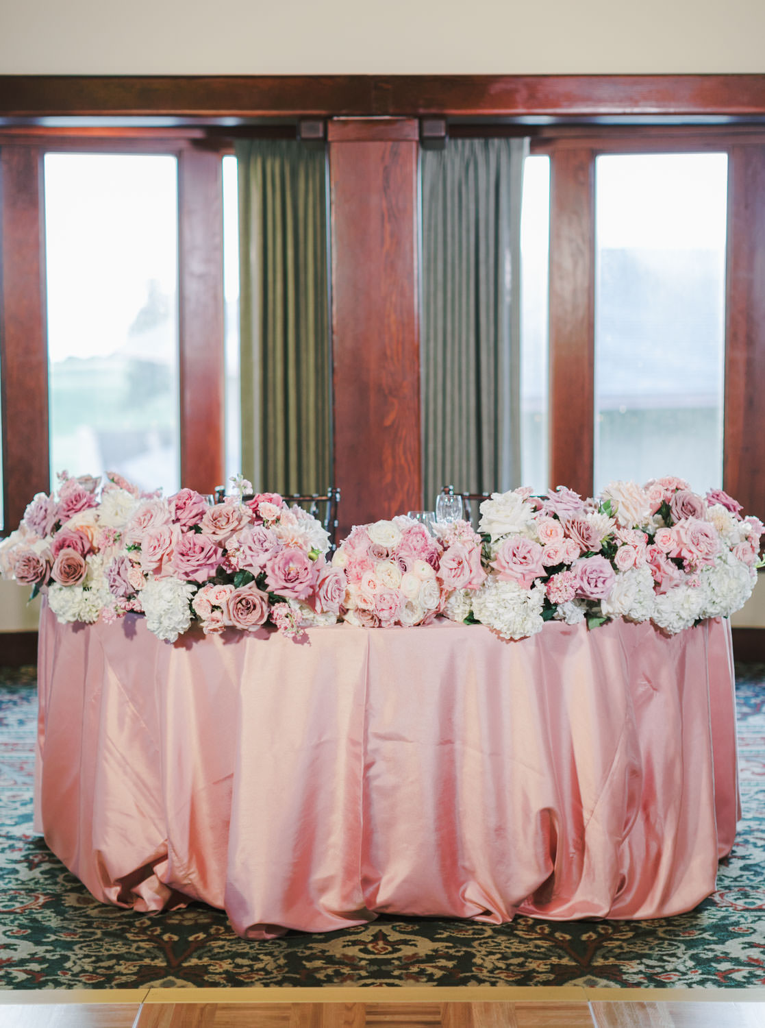 Ballroom wedding with pink linens, dark wooden chiavari chairs, and centerpieces with pink, lavender, and white flowers, The Lodge at Torrey Pines wedding, photography by Cavin Elizabeth Photography