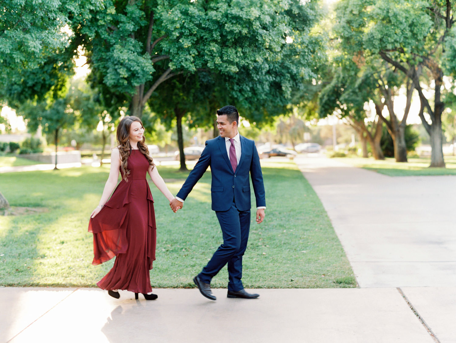 UC Riverside Engagement photos. Bride in long berry marsala dress and groom in navy suit. Film photographer Cavin Elizabeth Photography.