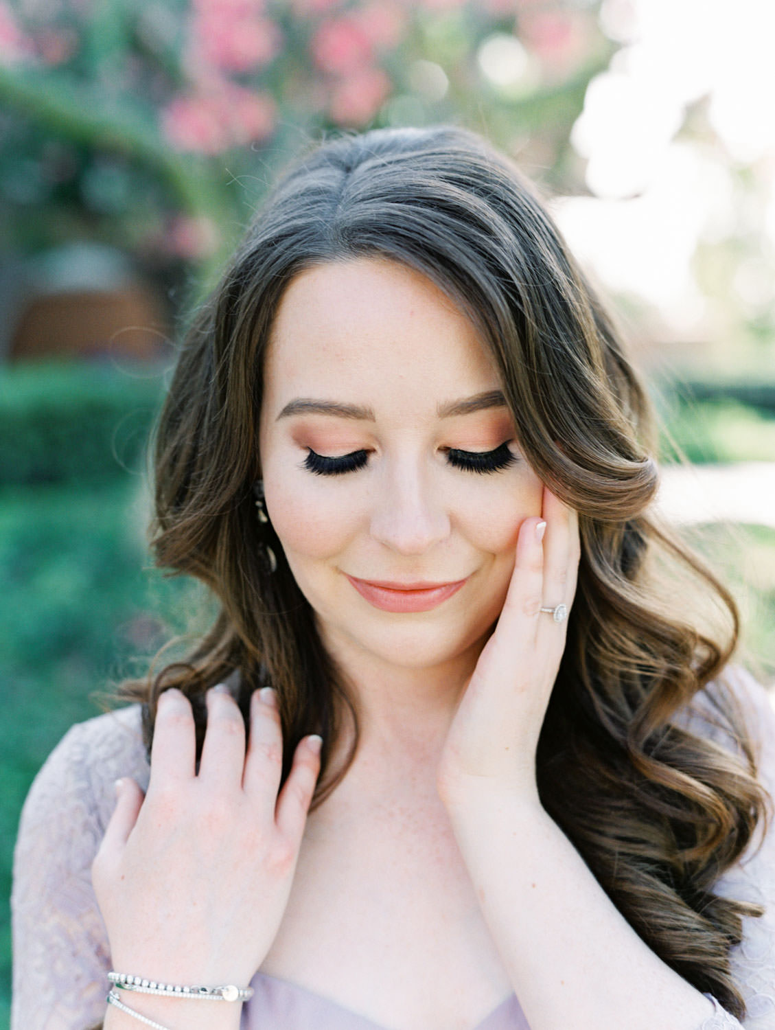 UC Riverside Engagement Photos. Bride in long blush lavender dress with hair down and curled and dramatic lashes and liner. Film photographer Cavin Elizabeth Photography.