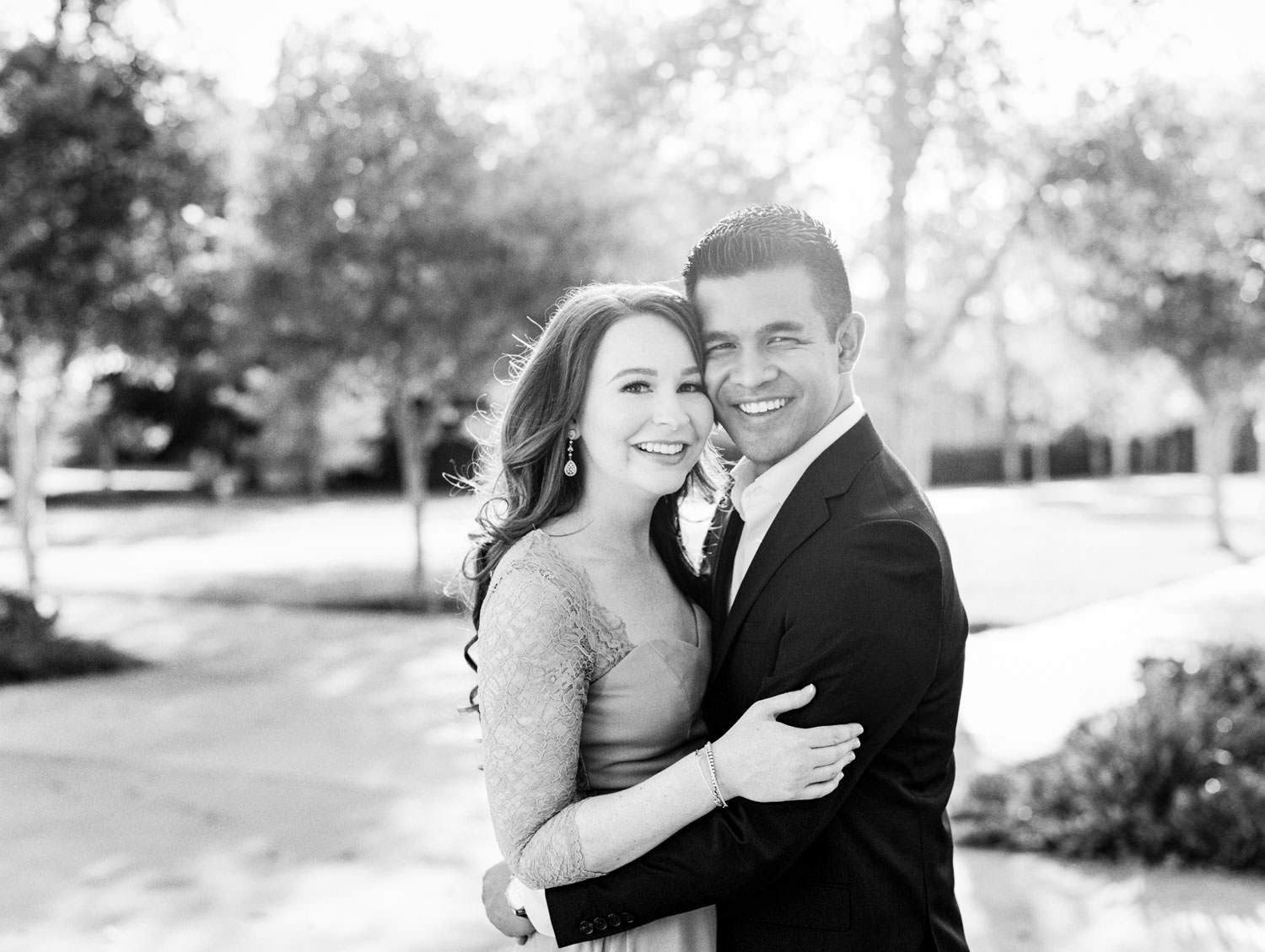 UC Riverside Engagement session. Bride in long blush lavender dress and groom in navy suit captured on black and white. Film photographer Cavin Elizabeth Photography.