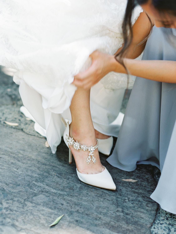 Bride getting into her Esperanza Badgley Mischka heels. Film photo by Cavin Elizabeth Photography