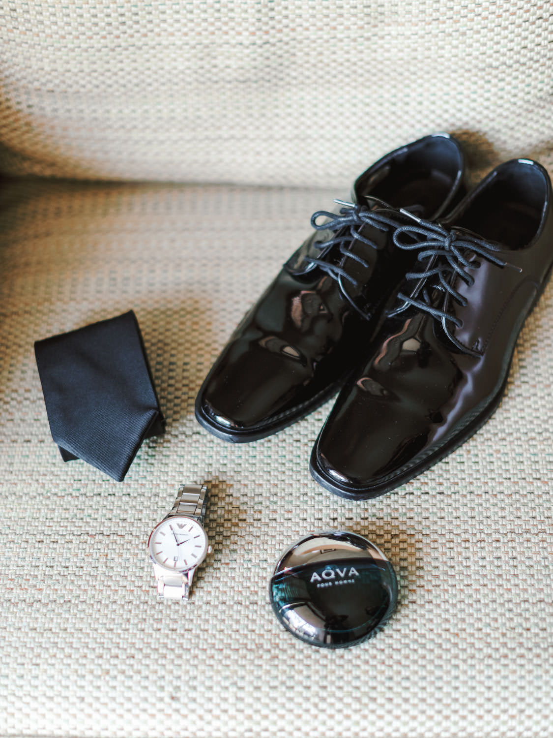 Groom black shoes, tie, watch, and cologne. Cavin Elizabeth Photography