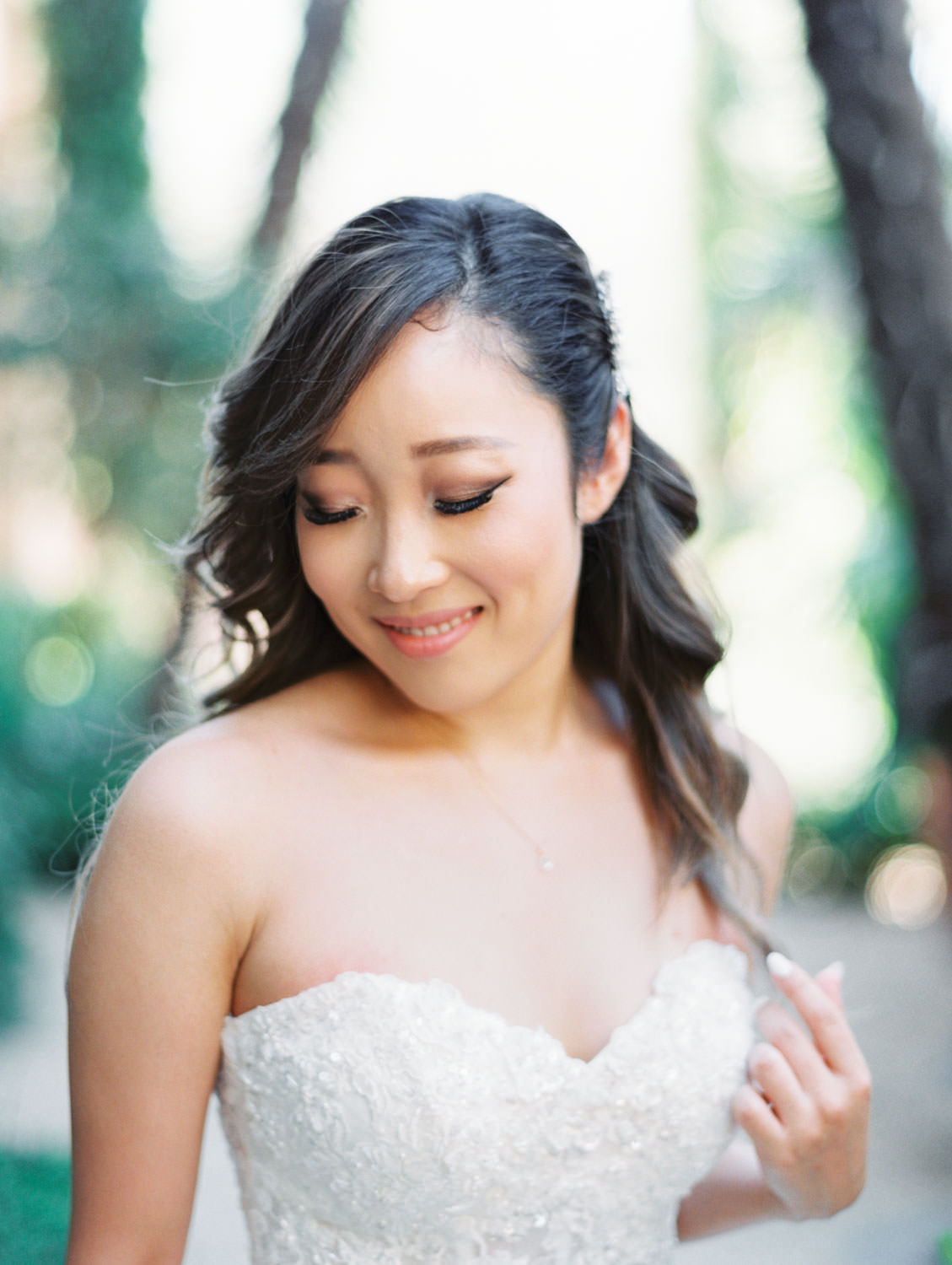 Bride in a Martina Liana gown from the White Flower Bridal Boutique. Hair down and curled. Rancho Bernardo Inn wedding. Film photo by Cavin Elizabeth Photography