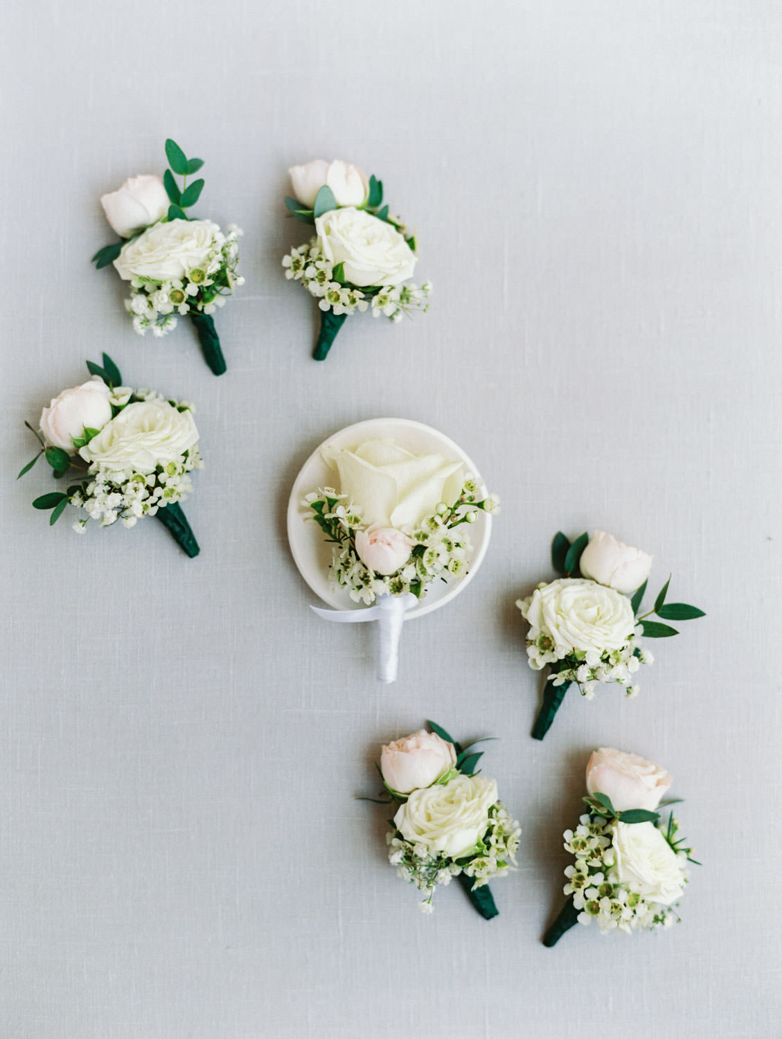 Ivory rose boutonnieres with pop of green. Wedding at Rancho Bernardo Inn. Film photo by Cavin Elizabeth Photography