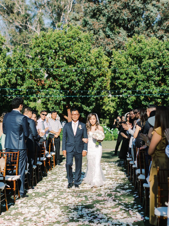 Bride and her father walking down the aisle. Bride in Martina Liana gown. Rancho Bernardo Inn Aragon lawn wedding ceremony. Cavin Elizabeth Photography
