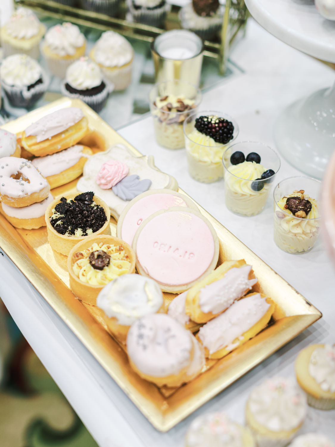 Dessert table with custom wedding date cookies, tartlets, eclairs, and cake cups. Wedding at Rancho Bernardo Inn in the Aragon Ballroom. photo by Cavin Elizabeth Photography
