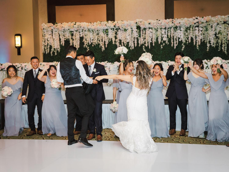 Bride and groom grand entrance. Wedding at Rancho Bernardo Inn in the Aragon Ballroom. photo by Cavin Elizabeth Photography