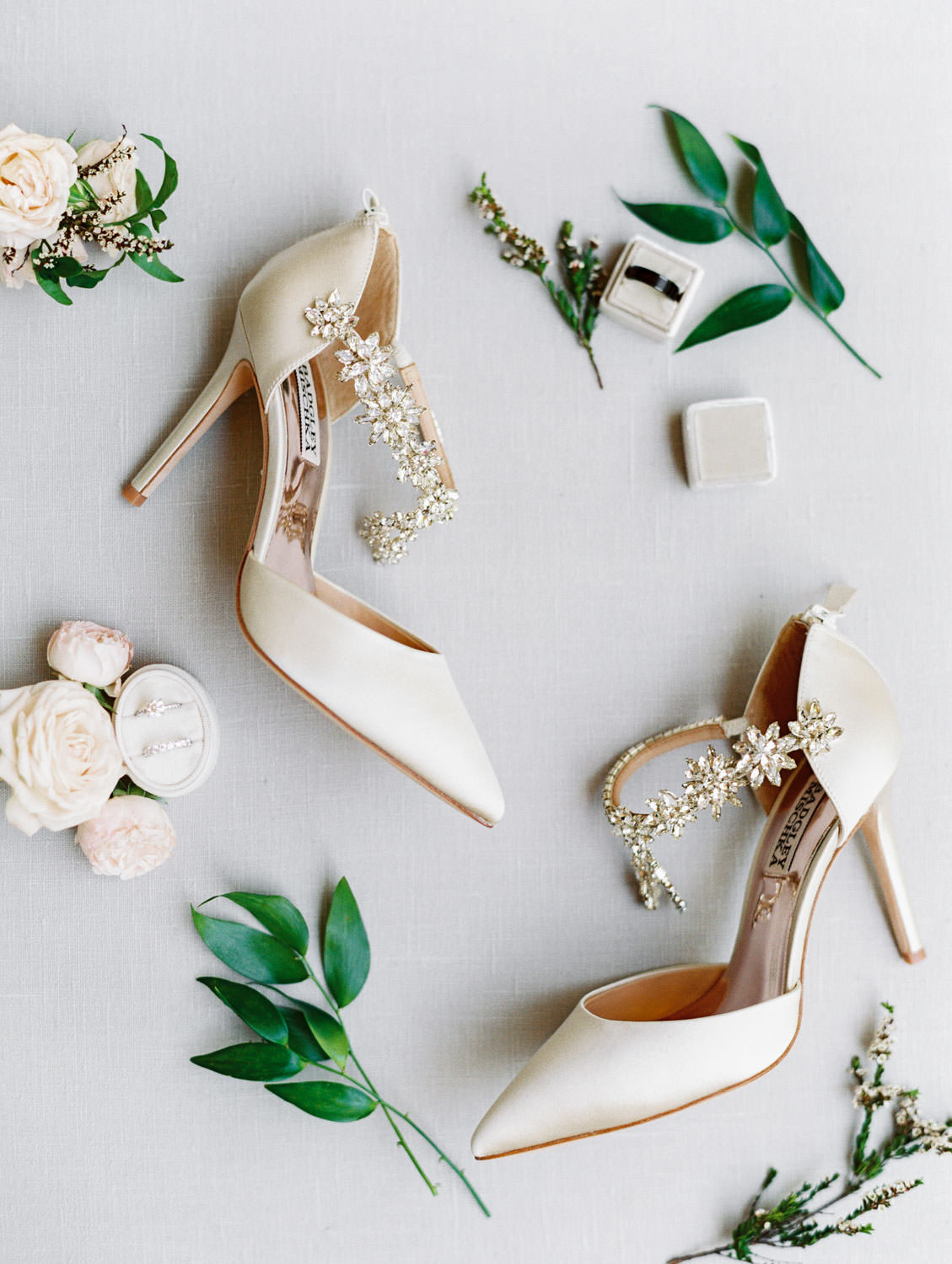 Brides Badgley Mischka Esperanza ivory heels with jewels styled with greenery. Wedding at Rancho Bernardo Inn. Film photo by Cavin Elizabeth Photography