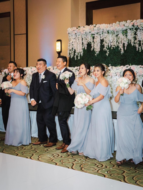 Bride and groom first dance reactions. Wedding at Rancho Bernardo Inn in the Aragon Ballroom. photo by Cavin Elizabeth Photography