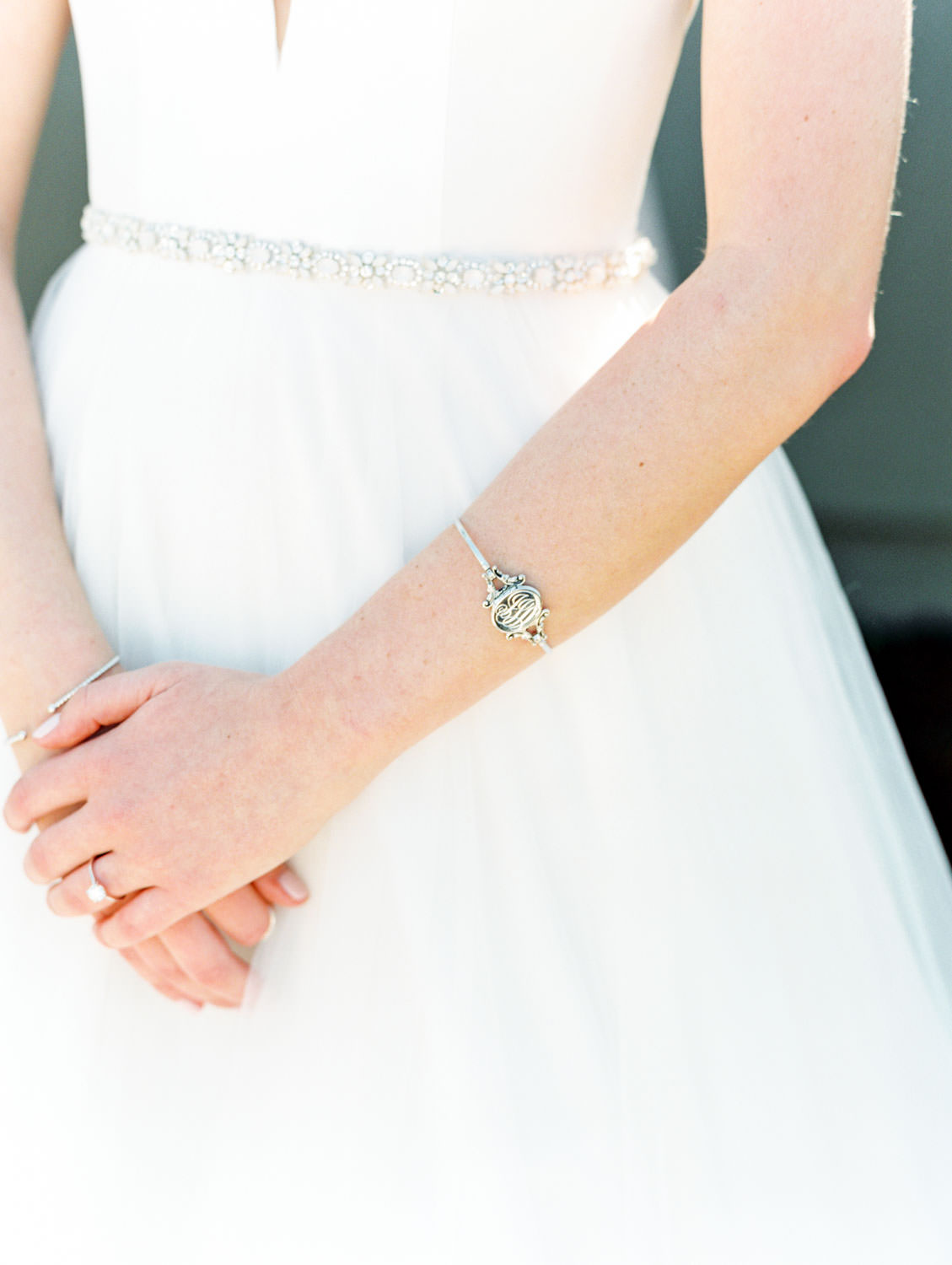 Bride wearing monogram silver bracelet. Estancia La Jolla wedding shot on film by Cavin Elizabeth Photography. Estancia La Jolla wedding shot on film by Cavin Elizabeth Photography