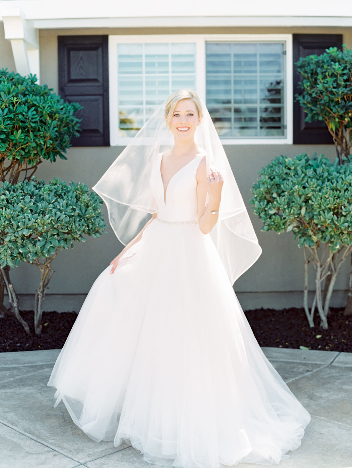 Bride in Stella York gown and veil for a classic bridal portrait. San Diego wedding shot on film by Cavin Elizabeth Photography