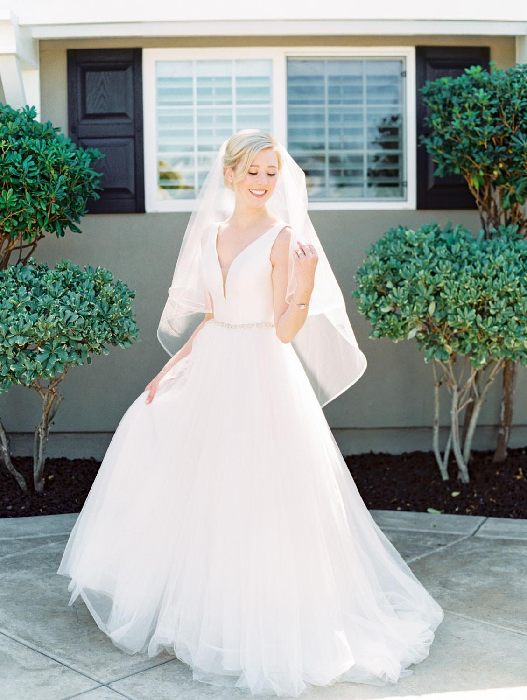 Bride in Stella York gown and veil for a classic bridal portrait. San Diego wedding shot on film by Cavin Elizabeth Photography