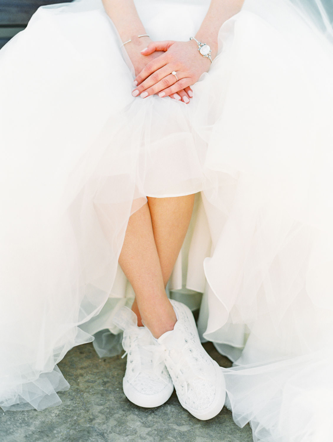 Bride in Stella York gown with eyelet bridal sneakers. San Diego wedding shot on film by Cavin Elizabeth Photography