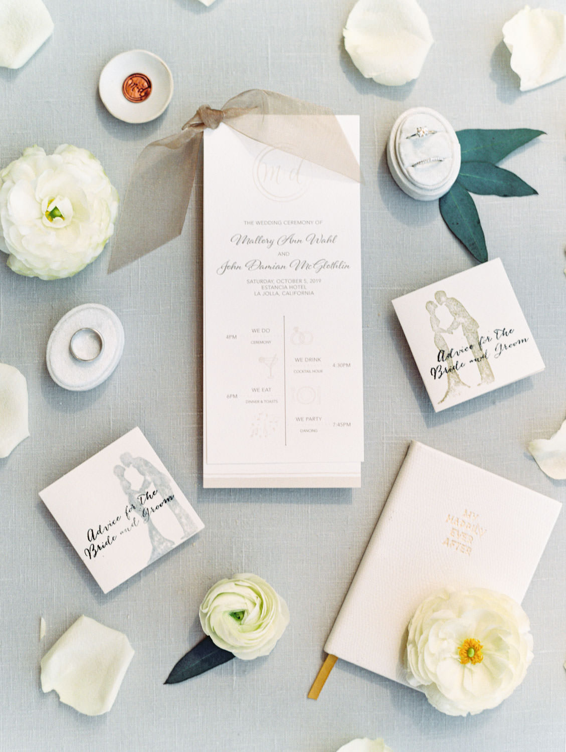 Ivory ceremony program with taupe ribbon. Advice for the bride and groom cards styled with ring box, vow book, and flowers. Estancia La Jolla wedding shot on film by Cavin Elizabeth Photography