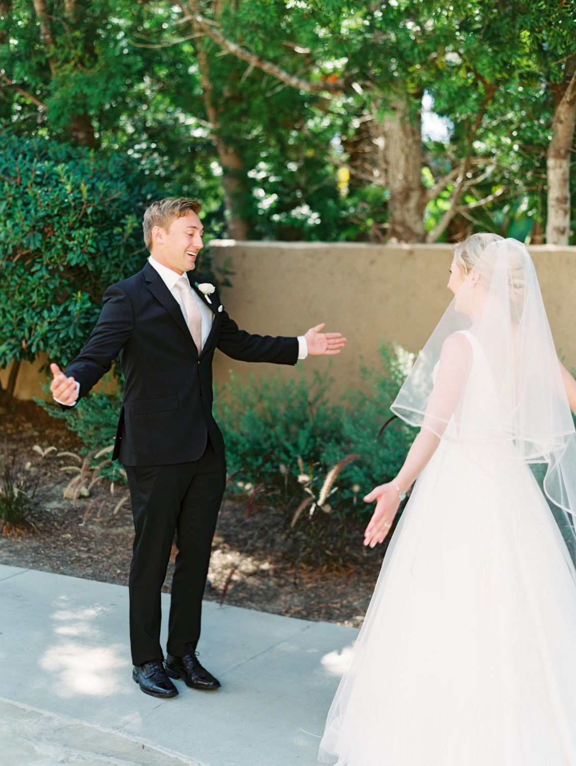 Bride and groom cute first look. La Jolla wedding shot on film by Cavin Elizabeth Photography