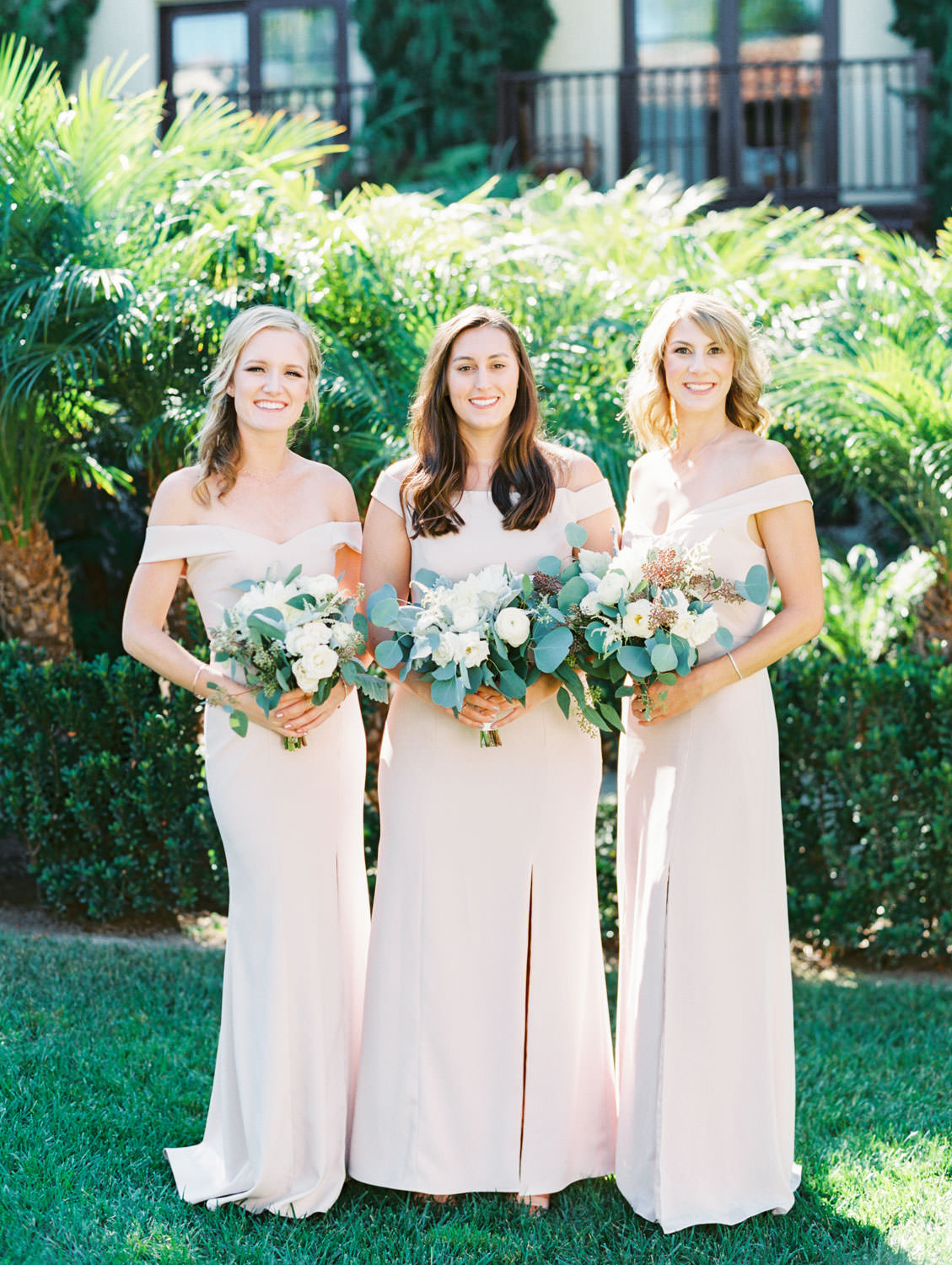 Bridal party portrait with blush gowns with dahlia and rose ivory bouquet with silver dollar eucalyptus. La Jolla wedding shot on film by Cavin Elizabeth Photography