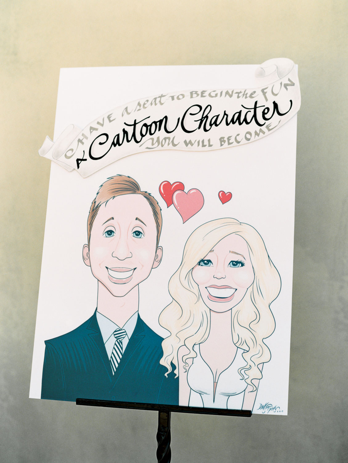 Caricature art of the bride and groom for their wedding cocktail hour. Turn guests into cartoon characters for a fun and unique activity that's interactive. Estancia La Jolla wedding shot on film by Cavin Elizabeth Photography