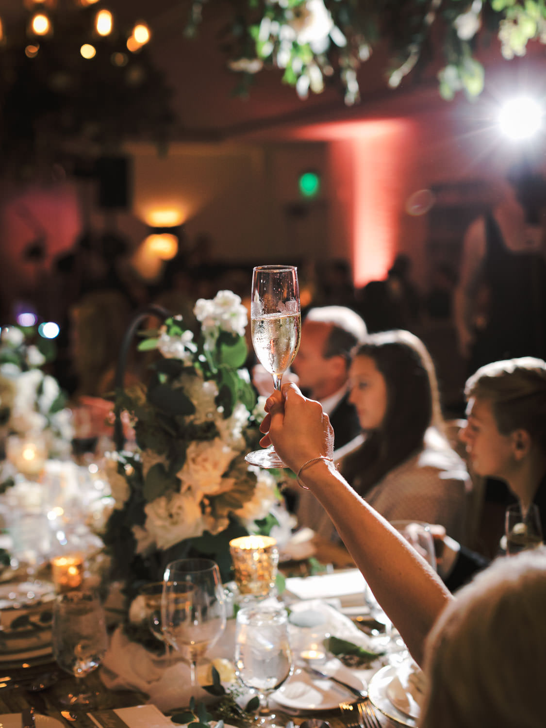 Backlit champagne toast. Estancia La Jolla Grande Room reception by Cavin Elizabeth Photography
