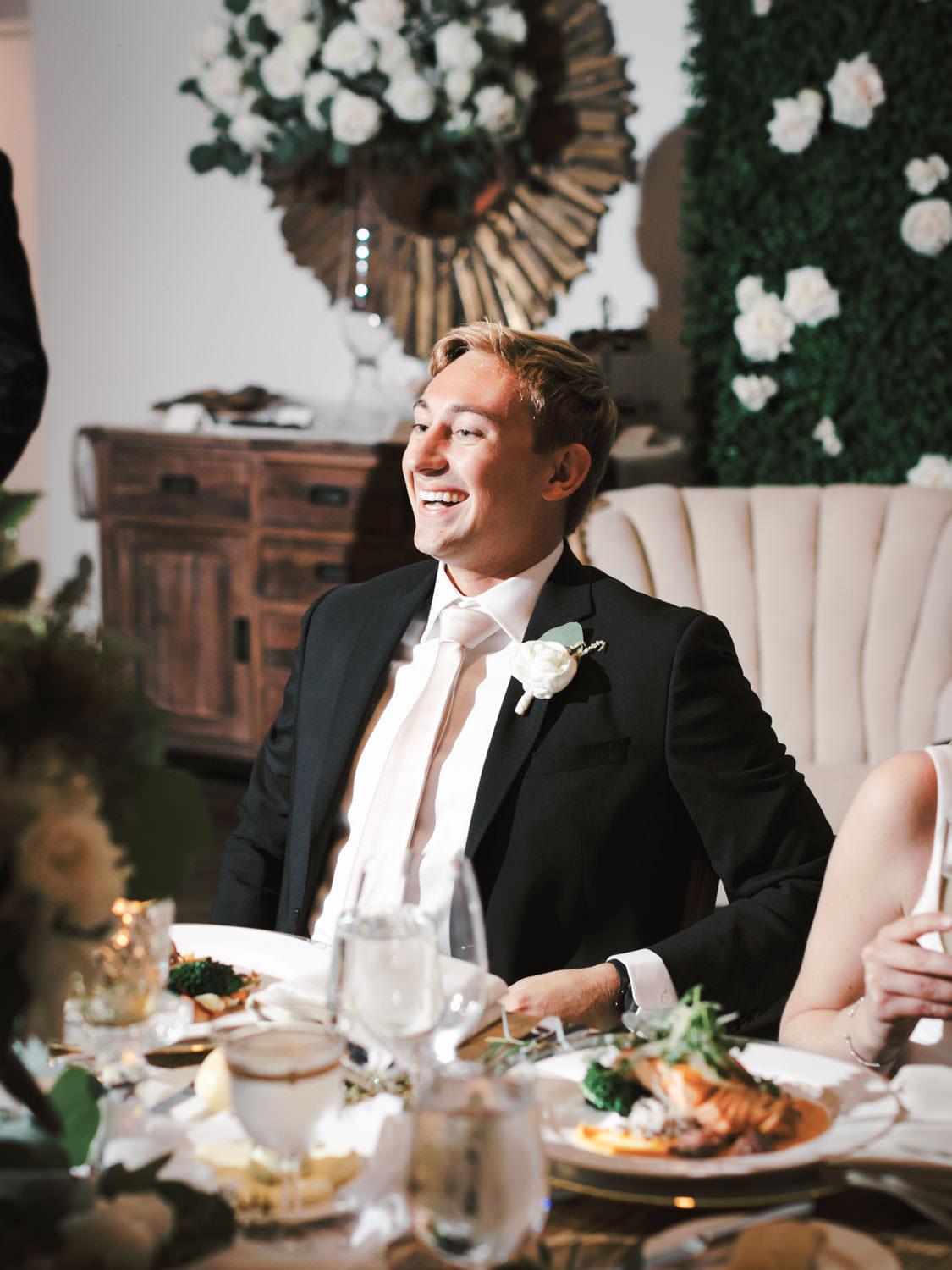 Groom reacting to wedding toasts. Estancia La Jolla Grande Room reception by Cavin Elizabeth Photography