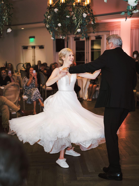 Father daughter dance showing off bride's white sneakers. Estancia La Jolla Grande Room reception by Cavin Elizabeth Photography