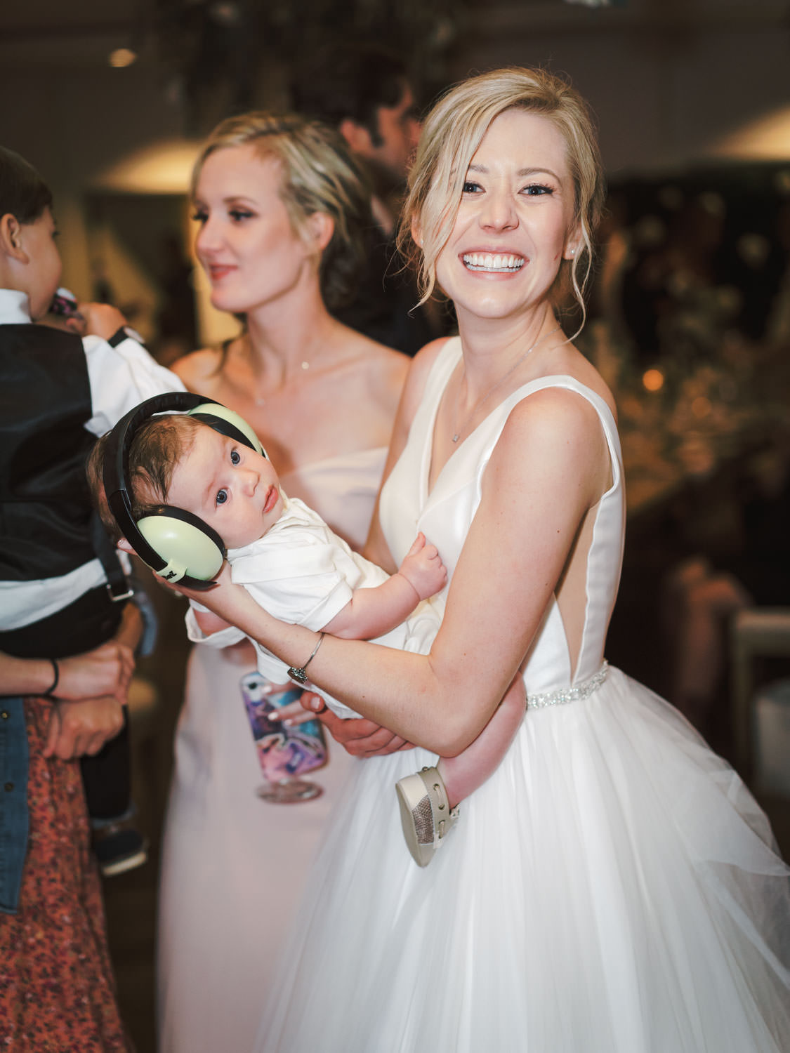 Bride dancing with her baby nephew. Estancia La Jolla Grande Room reception by Cavin Elizabeth Photography