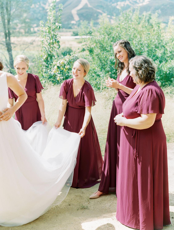 Bridesmaids in deep wine gowns by Show Me Your Mumu. Full Belly Farm on Martha Stewart Weddings by film photographer Cavin Elizabeth Photography