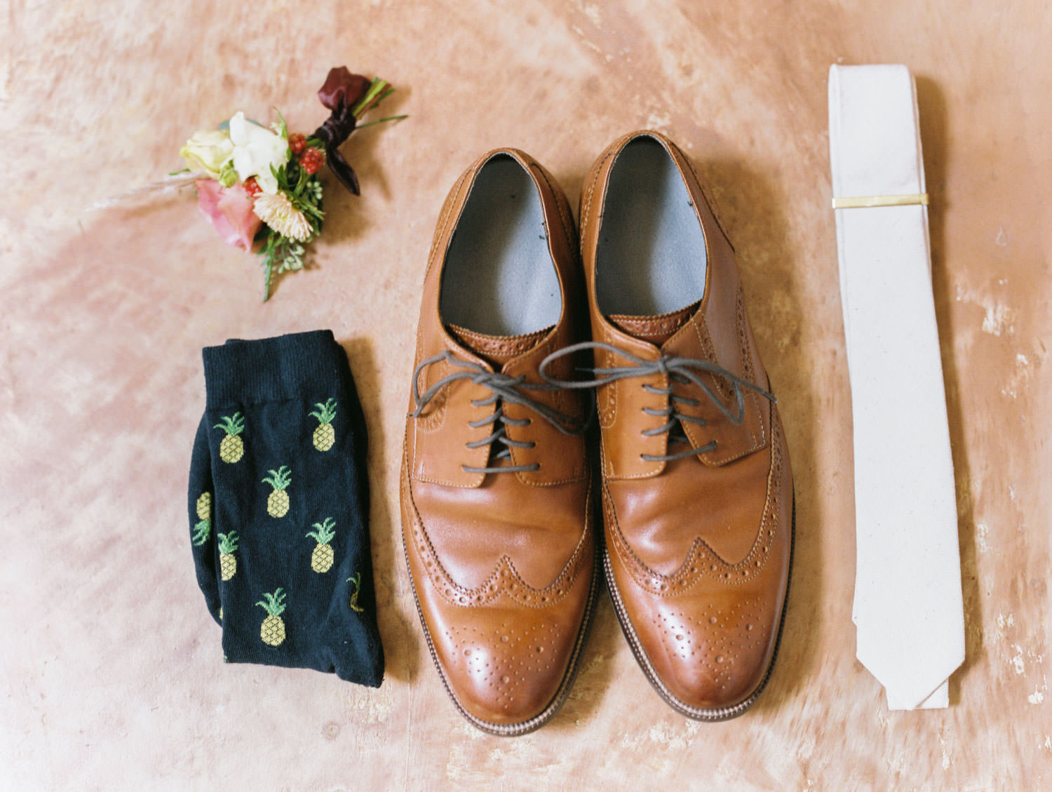 Groom details with brown leather shoes, fun pineapple socks, and ivory tie. Cavin Elizabeth Photography.