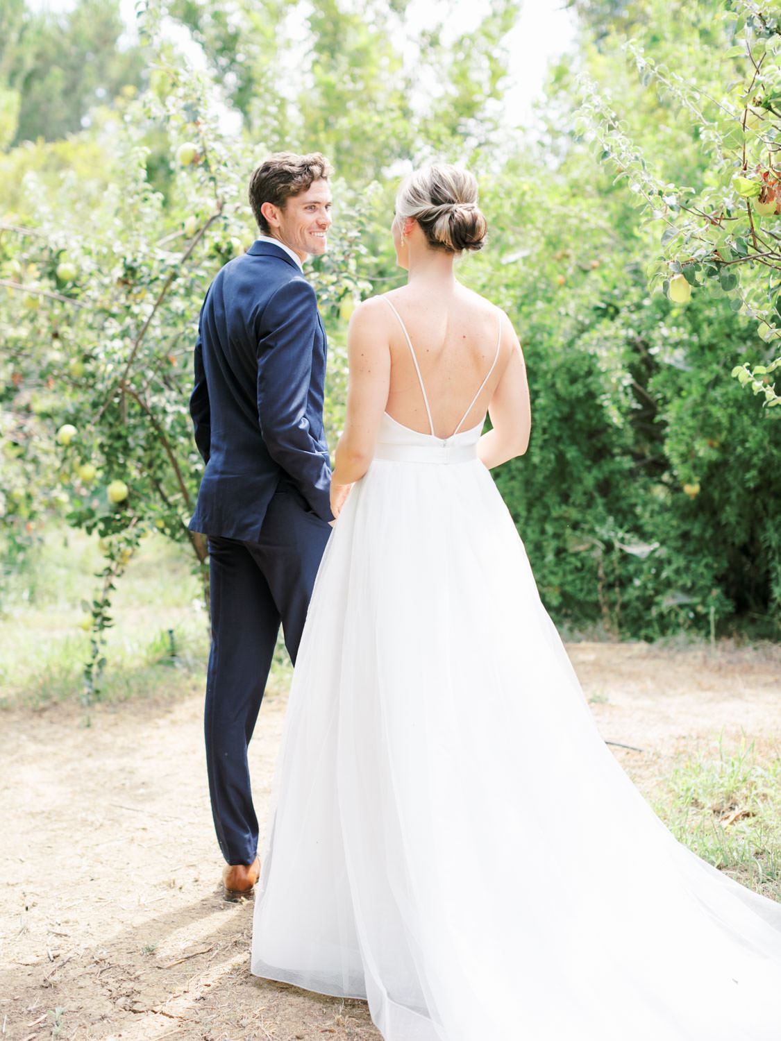 Bride walking to the first look in her classic Mikaella Bridal gown. Full Belly Farm on Martha Stewart Weddings by film photographer Cavin Elizabeth Photography