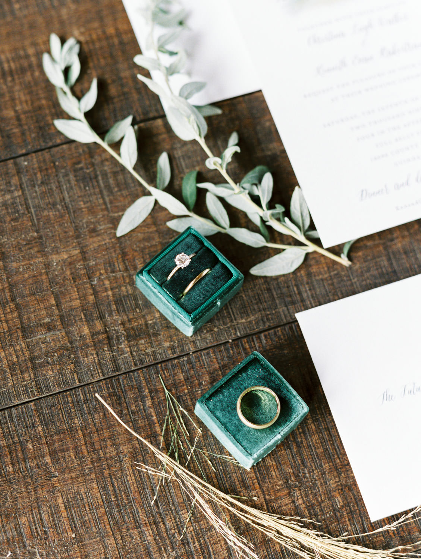 Wedding rings in Ellington double Mrs Box velvet ring box on a wooden floor. Cavin Elizabeth Photography