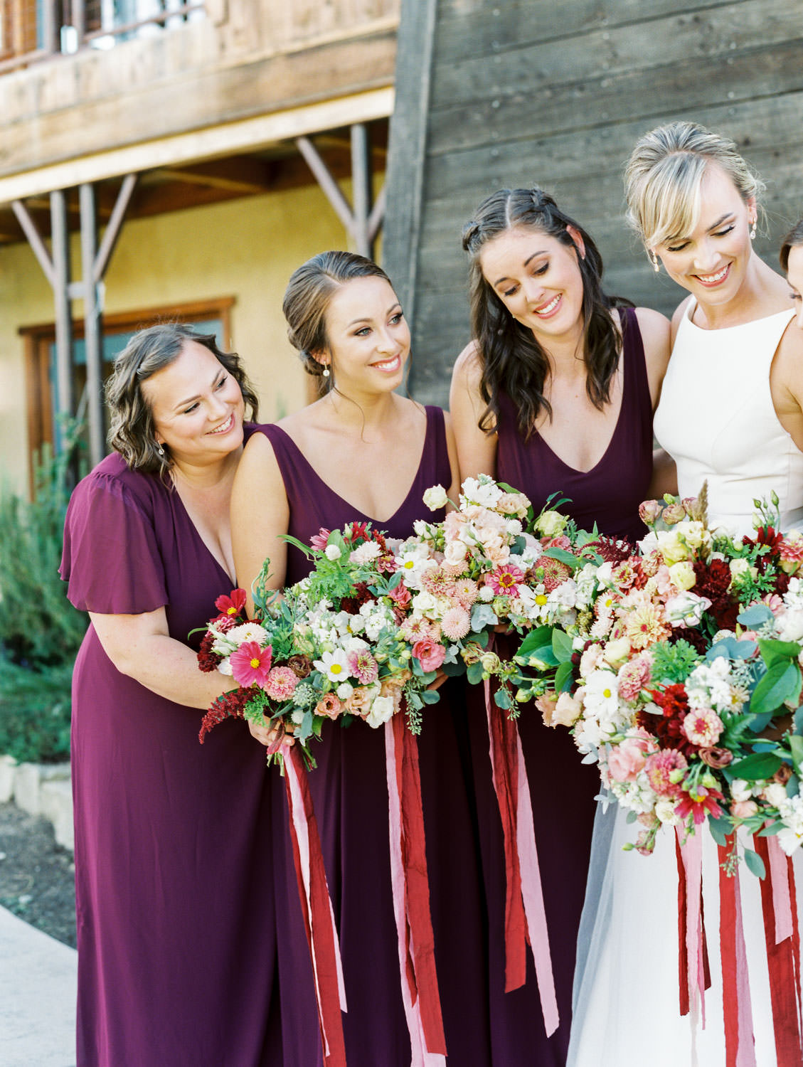 Bridesmaids in deep wine gowns by Show Me Your Mumu with bouquets of ivory, peach, wine, blush flowers and mauve, wine, and blush ribbons. Bridal party portrait with the bride. Full Belly Farm on Martha Stewart Weddings by film photographer Cavin Elizabeth Photography
