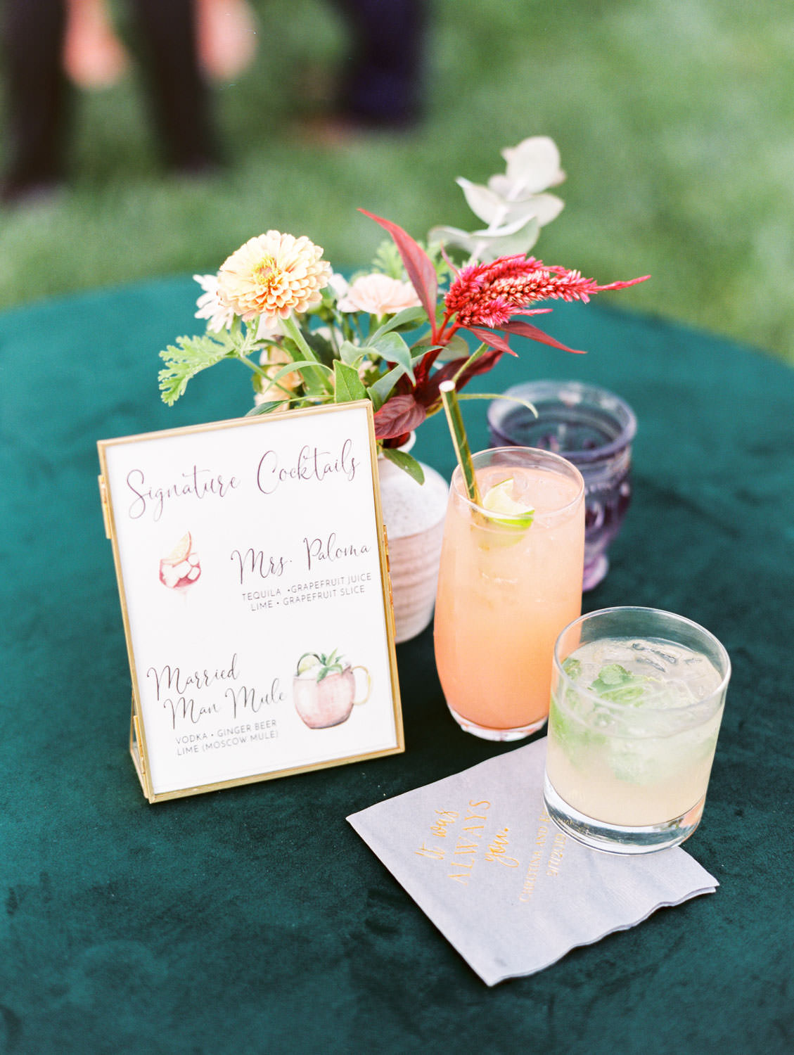 Teal green velvet cocktail table linen with signature cocktails and watercolor sign. Punny drink names. Full Belly Farm reception by film photographer Cavin Elizabeth Photography